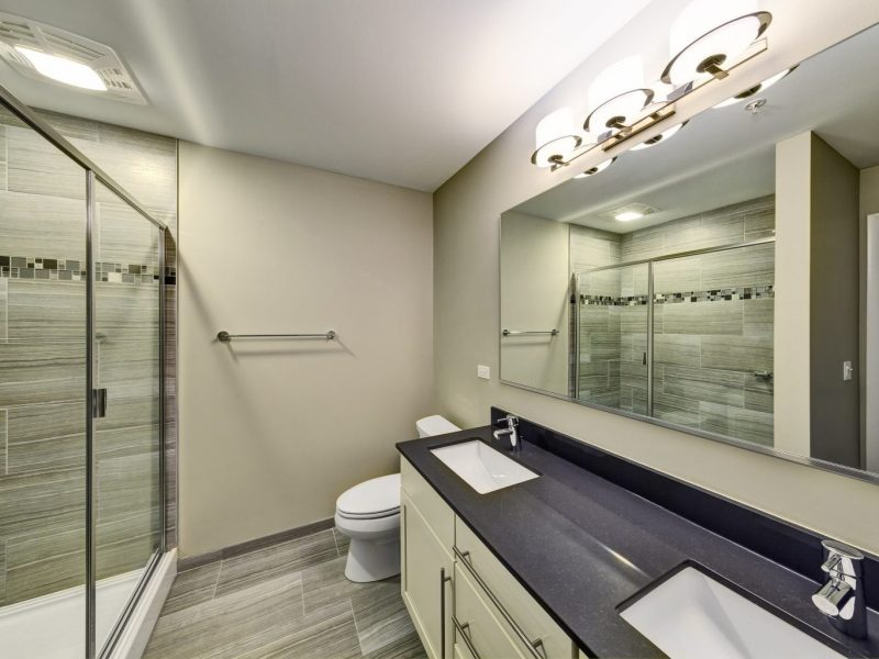 This image shows a bathroom area with designer ceramic tile floors and tub surrounds.