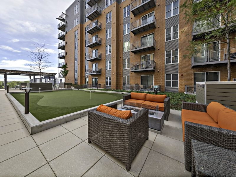 This image shows the fire pits with lounge seating that overview outdoor putting green area.