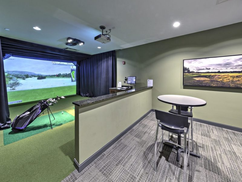 This image shows the virtual-reality golf simulator that will improve your game.