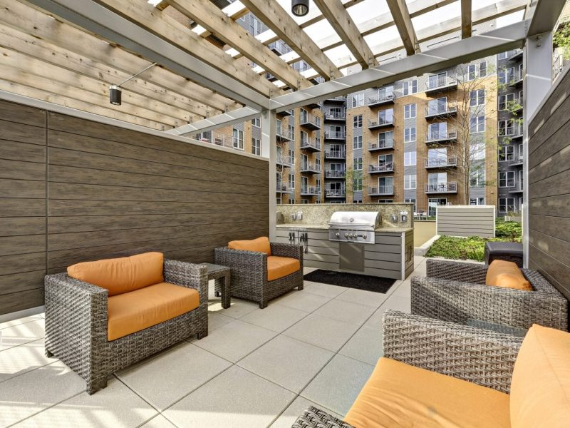 This image shows the outdoor lounge and grilling station area.