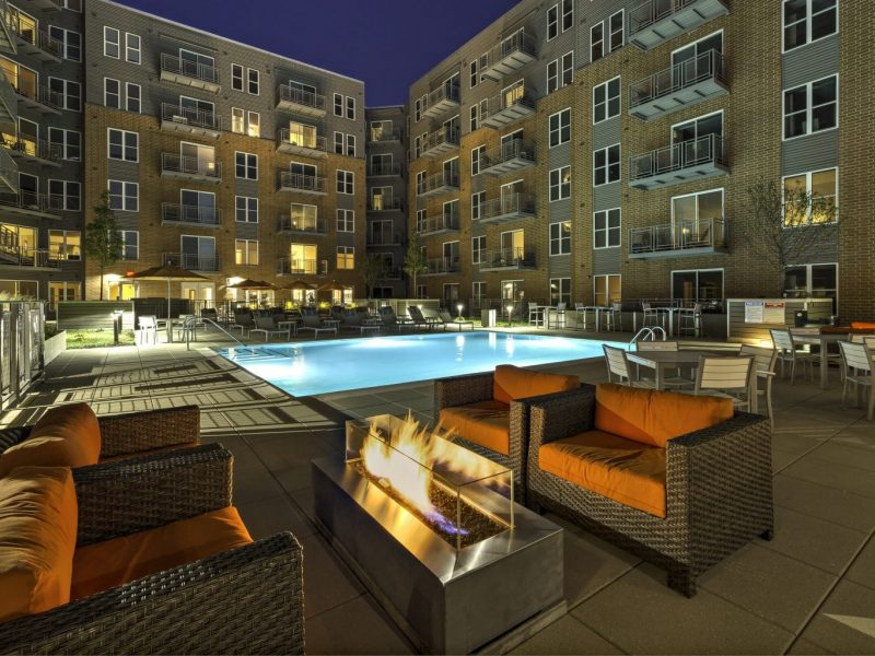 This image shows the resort-style outdoor swimming pool that overlooks the tall TGM NorthShore establishment and bringing the luxurious water experience with light effects during night swimming. The pool area is also accessible to the fire pits that were ideal for fun moments with family and friends.